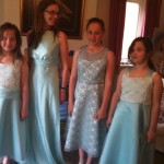 Three bridesmaid style dresses