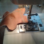 Sewing a gingerbread man