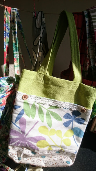 green canvas flower bag